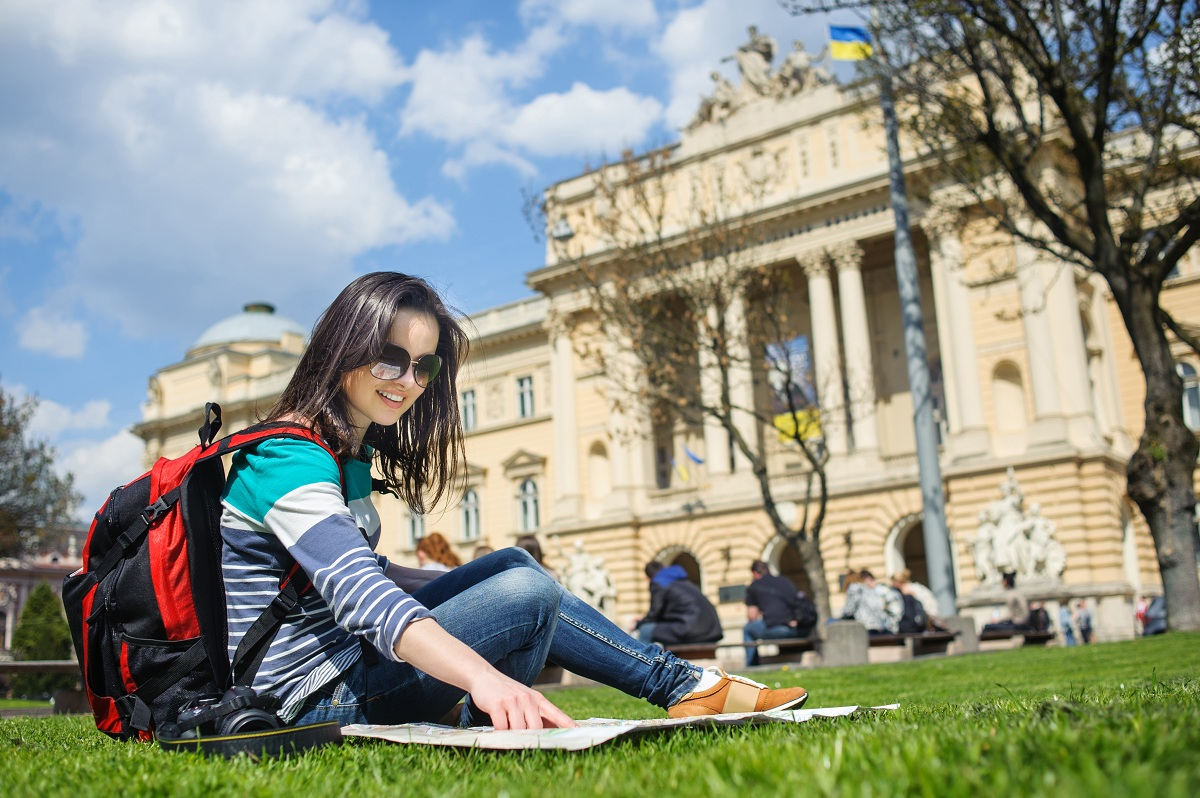 exchange student sitting on the grass